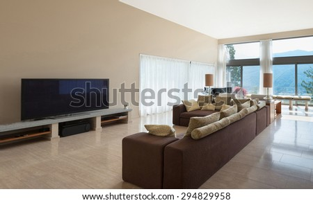 Interior of a modern living room, comfortable divan - stock photo