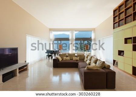 Interior of a modern living room, comfortable divan - stock photo