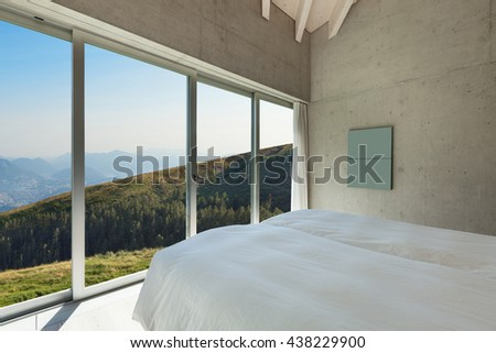 Interior of a modern loft in cement, bedroom - stock photo