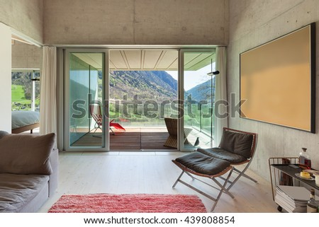 Interior of a modern loft, living with veranda. concrete walls - stock photo