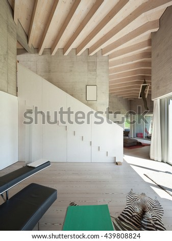 Interior of a modern loft, wide room with stair, concrete walls - stock photo
