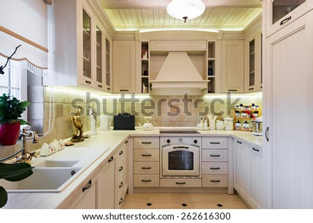 Interior of a modern luxury bright white kitchen - stock photo