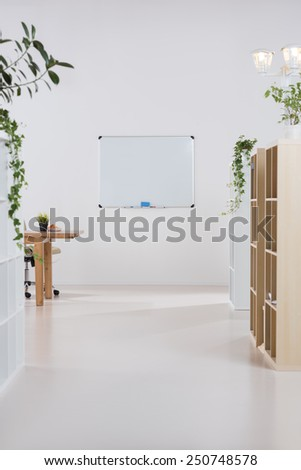 Interior of a modern office with plants and no people - stock photo