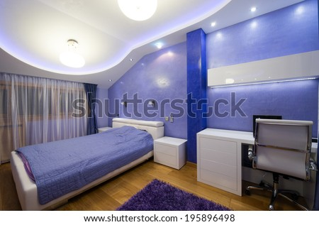 Interior of a modern purple bedroom with luxury ceiling  - stock photo