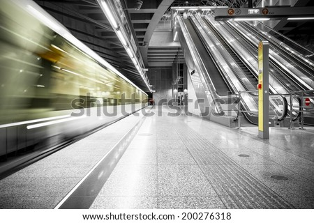 interior of a modern station, blurred train - stock photo