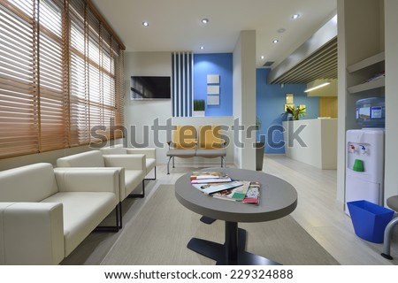 Interior of a modern waiting room. Clinical with empty chairs - stock photo