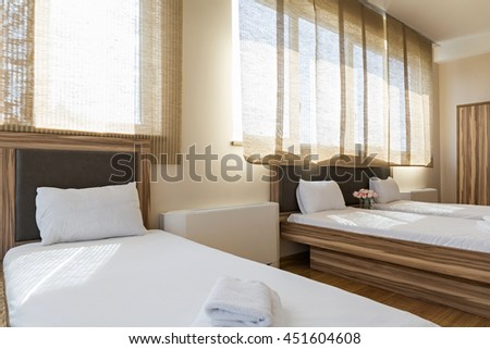 Interior of a new double bed hotel bedroom - stock photo