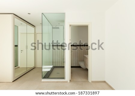 Interior of a new empty house, bathroom, shower view