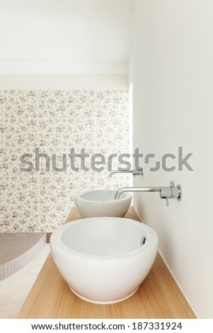 Interior of a new empty house, bathroom, sinks view - stock photo