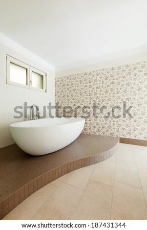 Interior of a new empty house, bathroom, view bathtub - stock photo