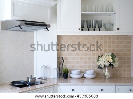 Interior of a new modern kitchen, white tone.