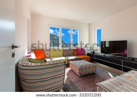 interior of a nice apartment furnished, sunny living room - stock photo