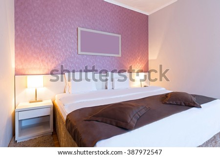 Interior of a pink hotel bedroom