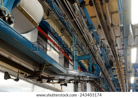 interior of a production factory with belt conveyor - stock photo