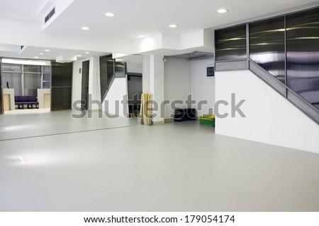 Interior of a room for exercise with large mirror - stock photo