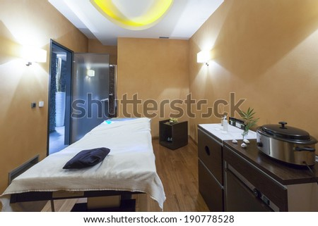Interior of a room for stone massage - stock photo