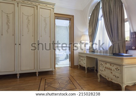 Interior of a room with antique furniture - stock photo