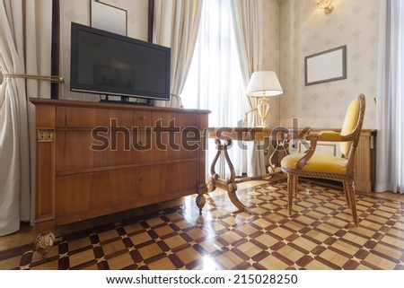 Interior of a room with antique furniture and TV - stock photo