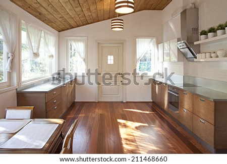 Interior of a roomy dining room in sunlight