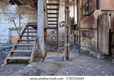 Interior of a ruined brick factory - stock photo