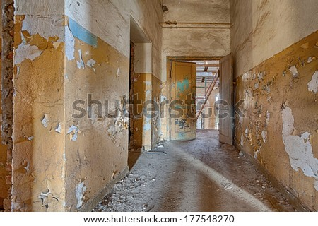 Interior of a ruined factory - stock photo