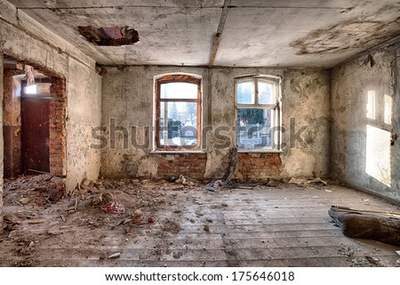 Interior of a ruined house - stock photo