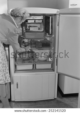Interior of a 1940's refrigerator has a small freezer section. The most perishable foods were stored near the freezer. The bottom compartment contained the refrigeration unit. 1942.