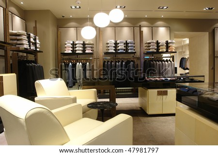 interior of a shop with white chairs - stock photo