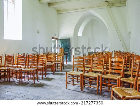 Interior of a small and basic medieval church - stock photo