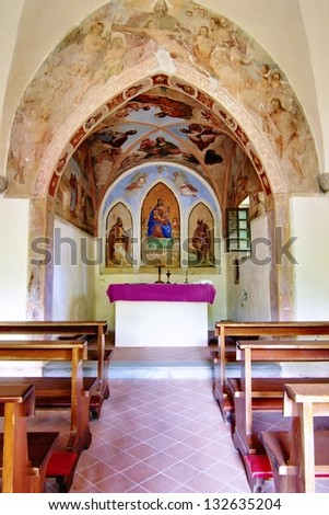 Interior  of a small country church in the woods near Osoppo, Italy - stock photo