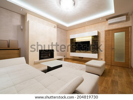 Interior of a specious living room with fireplace  - stock photo