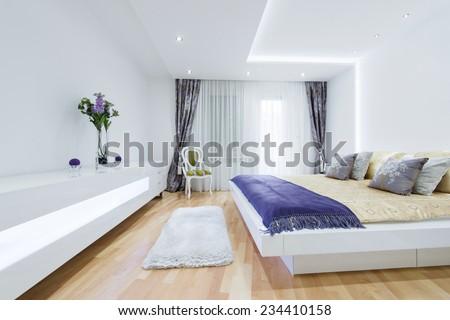 Interior of a specious luxury bedroom - stock photo