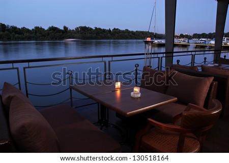 Interior of a summer terrace of night bar - stock photo