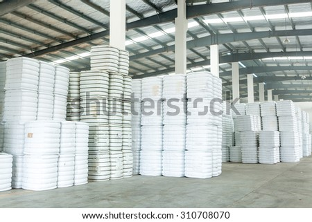 interior of a warehouse in a textile factory. - stock photo