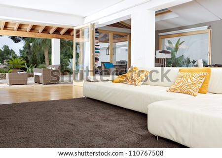 Interior of a well designed home's living room with garden views. - stock photo
