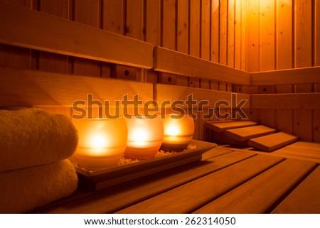 Interior of a wooden finnish sauna. - stock photo