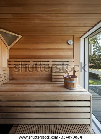 Interior of a wooden finnish sauna - stock photo