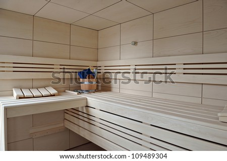 Interior of a wooden sauna - stock photo