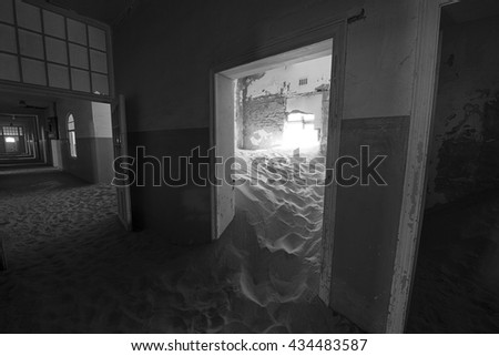 interior of abandoned building with desert sand filling the rooms