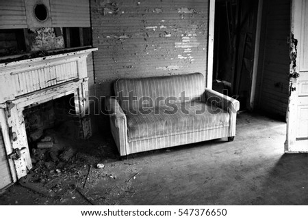 Interior of abandoned mill workers home in black and white