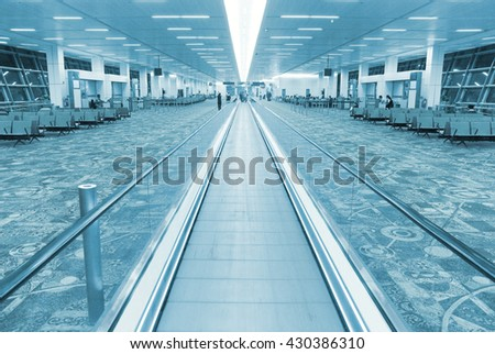 Interior of airport hall with the flat escalator. Blue colorized image - stock photo