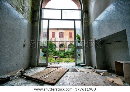 interior of an abandoned building in ruins - stock photo