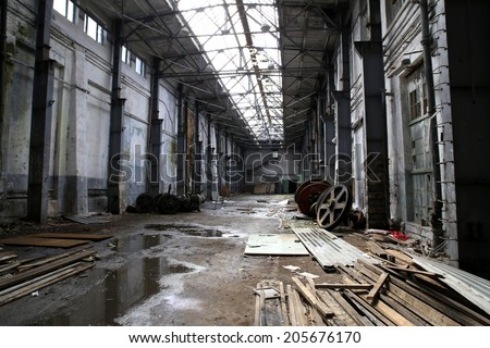 interior of an abandoned factory - stock photo