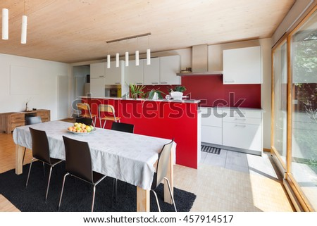 Interior of an eco house, modern kitchen and dining table