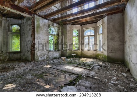 Interior of an old destroyed house - stock photo