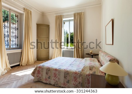 Interior of an old mansion, new bedroom in classical style