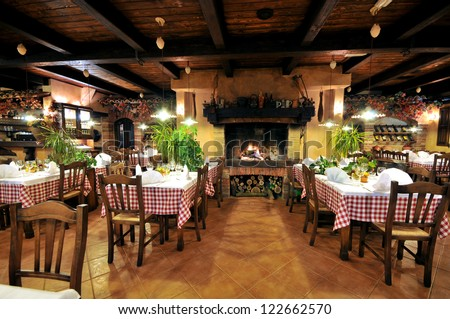 Interior of an old tavern with old wooden furniture. - stock photo