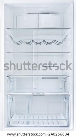 Interior of an open empty white fridge - stock photo