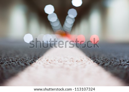 Interior of an urban tunnel without traffic from the ground level - shallow depth of field and  light bokeh - stock photo