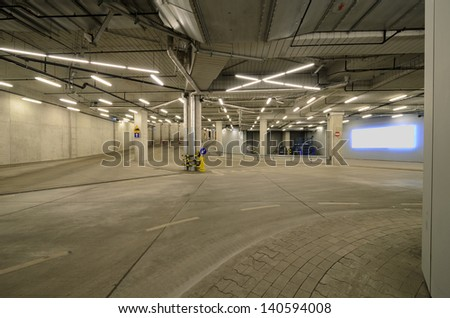 Interior of an urban tunnel without traffic with blank billboard - stock photo
